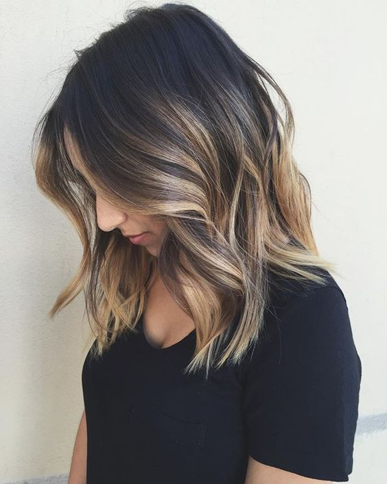 brunette curled hair with blonde ombre.jpg