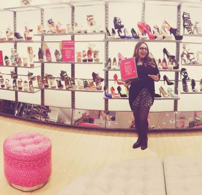 Showin' off promos in shoes as a Sales Associate at Charlotte Russe!