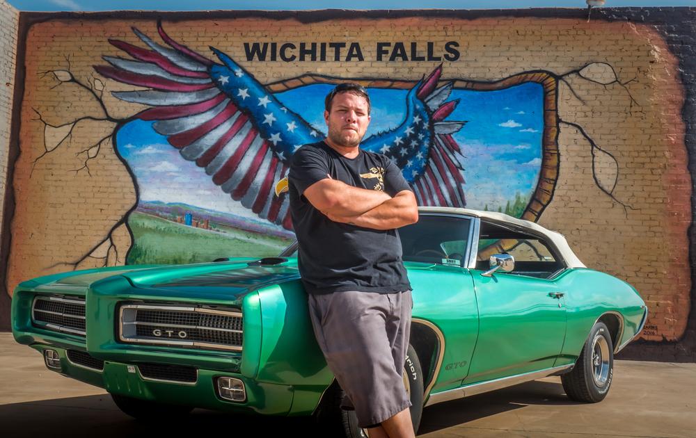Mr. Brett Humpert with his 1971 GTO. Wall mural by Mr. Ralph Stearns. Downtown Wichita Falls, Texas. ©SimeonHendrix
