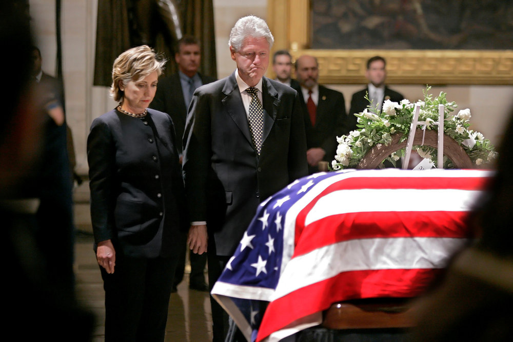President Bill Clinton and First Lady Hillary Clinton observe a moment of silence at President Gerald Ford's Funeral. Photo by Rex Larsen.