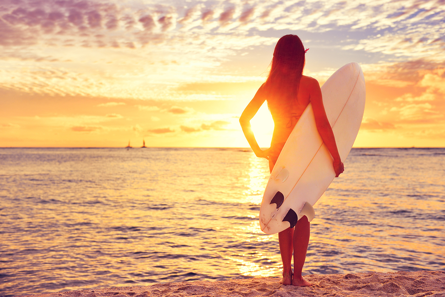 bigstock-Surfer-girl-surfing-looking-at-85475813.jpg