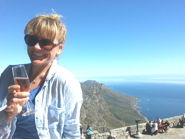 On top of Table Top Mountain, South Africa - Cheers to loving life, and it loving you right back!