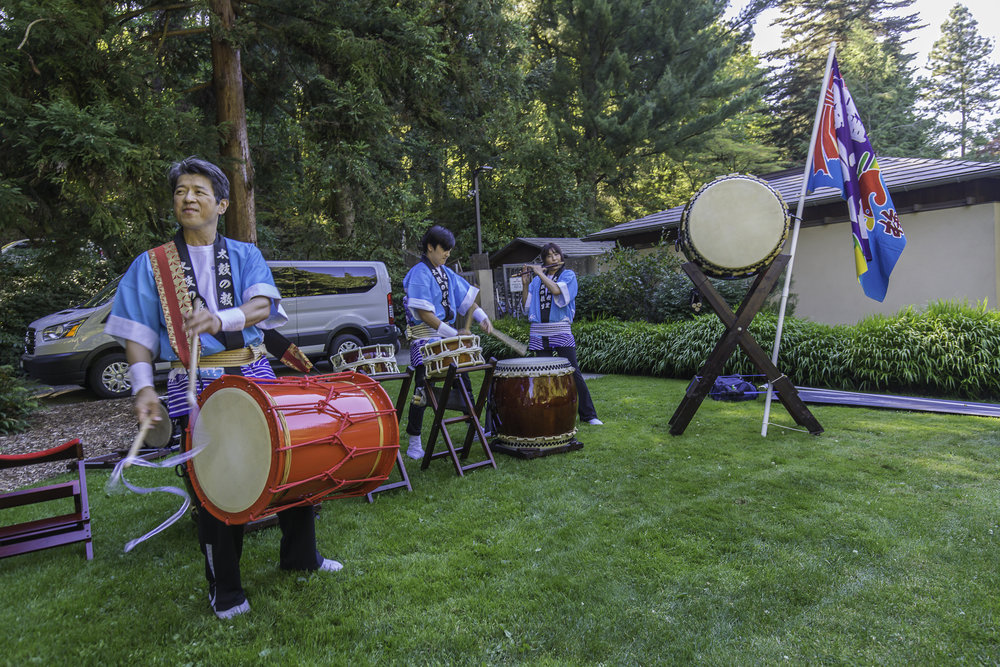 School of Taiko performing in the garden courtyard to welcome guests