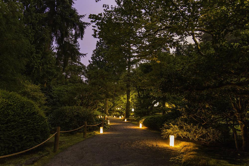 Luminaries lighting the pathways (Photo by SlickPix Photography)