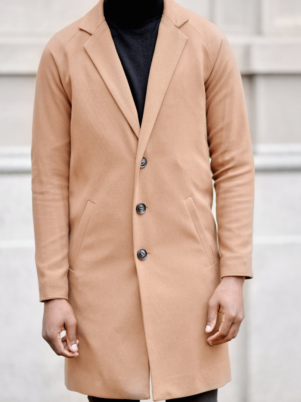 Tan overcoat and turtleneck