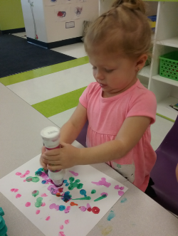 For art today since we have been talking about colors, we did paint dobber marker art. We created fantastic splatter art with lots of colors. We talked about colors as we were using them. We also practiced screwing the caps on and off working our fine motor skills.