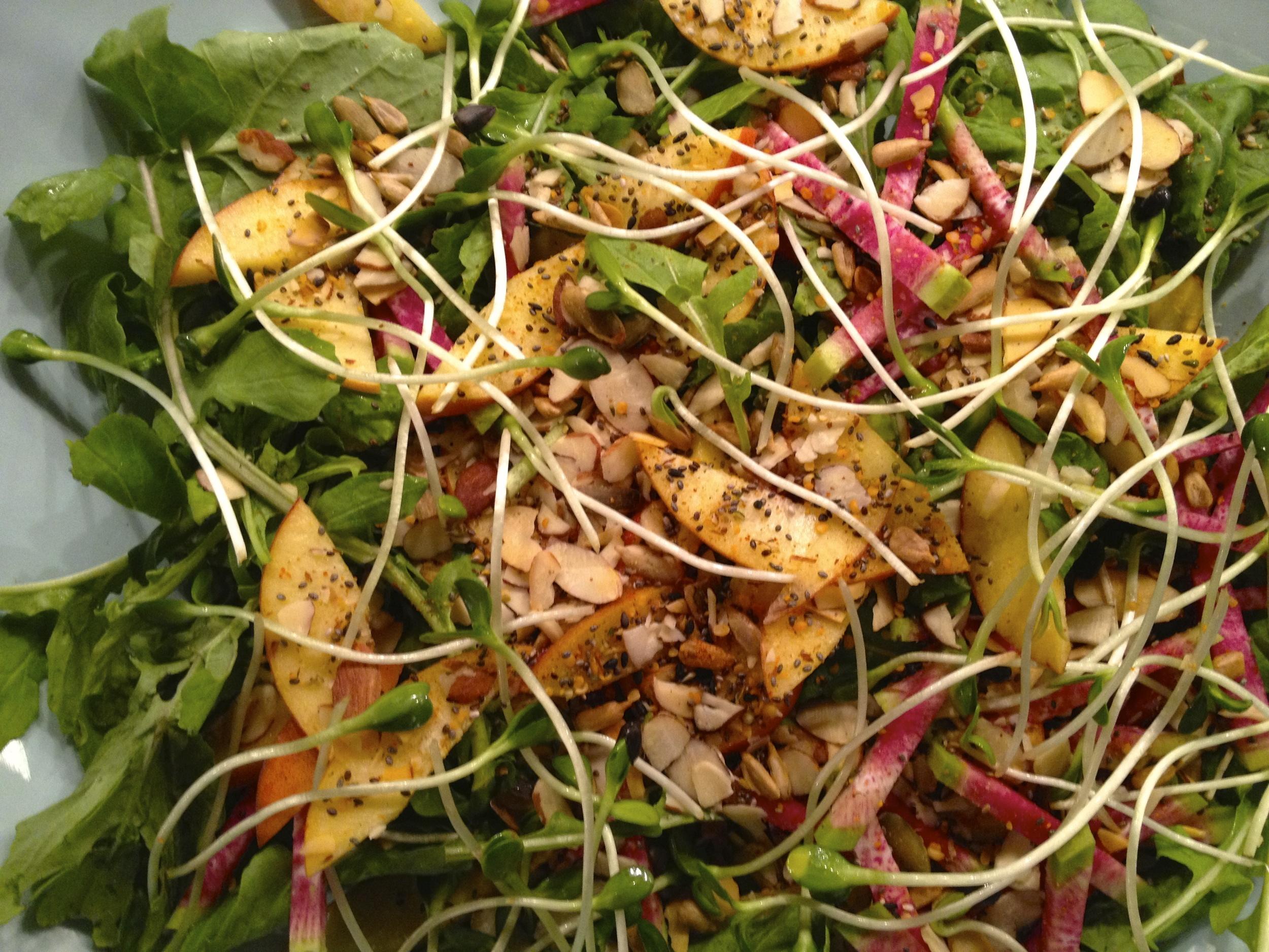 arugula salad with super seed mix and basil vinaigrette