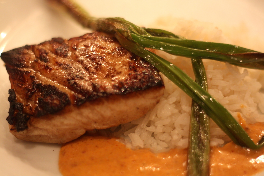 pan-seared halibut with red curry sauce and coconut rice
