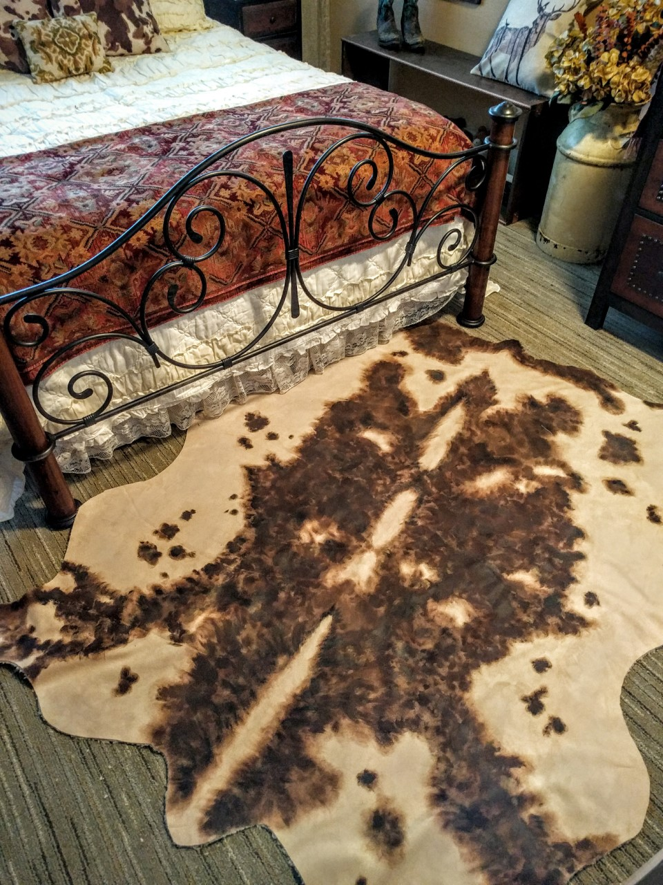 Painted faux cow skin rug