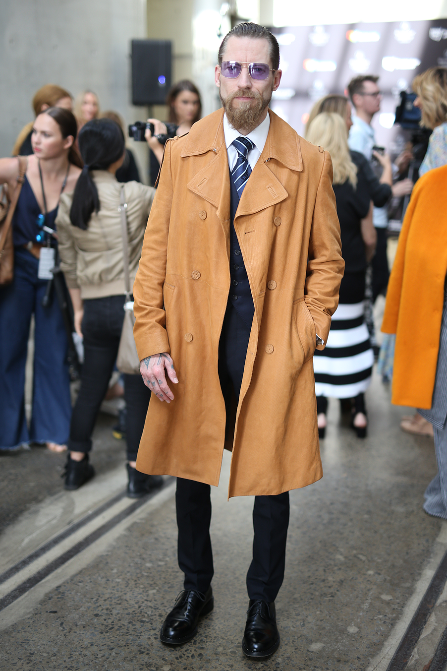 """The Coat is actually made out of Leather corduroy."" Justin Oshay Creative Director Brioni Menswear. Justin Oshay wears head to toe Louis Vuitton accessorised with sunglasses from Olivia Peoples."