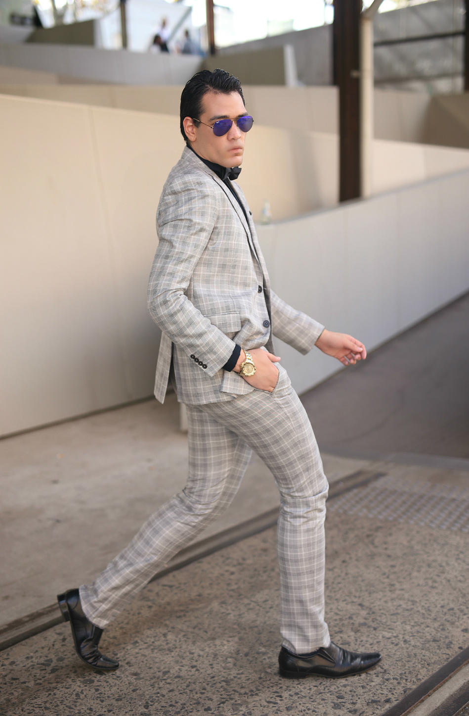 """Dress to be the best version of yourself not the second rate version of someone else."" Warren A Pasi- Stylist, Model and Content Creator. Warren wears Armani shirt and suit, Julius Marlow shoes and accessorised with watch by Karl Lagerfeld and sunglasses from Ray ban."