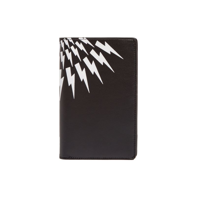 2. Passport holder - If you haven't got one already (which I highly doubt)get one, trust me these little things are amazing I always put my boarding pass, my pass port, spare cash and a spare credit card just in case I lose my wallet._NEIL BARRETTLeather Passport MATCHESFASHION