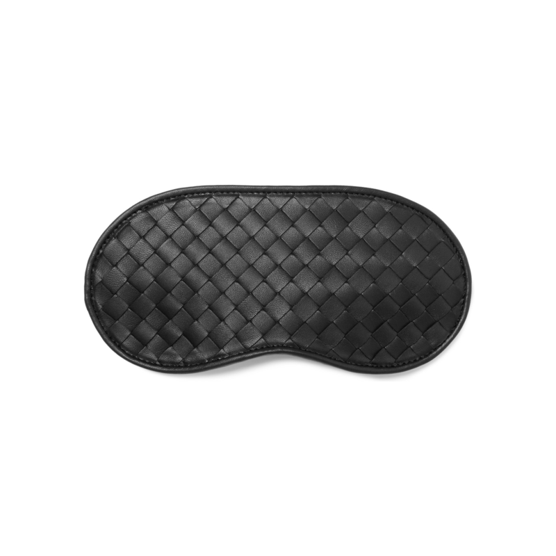 6. Eye mask - I love an eye mask because one it stops your neighbour from speaking to you on the flight and two I don't know about anyone else but sleeping on the plane is a little easier with one of these on._BOTTEGA VENETATerry-Backed Intrecciato Leather Eye MaskMRPORTER.COM