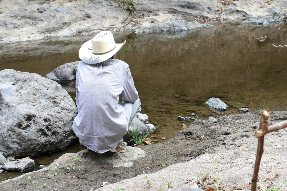 Amado Carillo surveys the Amatitán River, where he witnessed a massacre of 200 people, including his children, in 1982. / Photo Cristosal