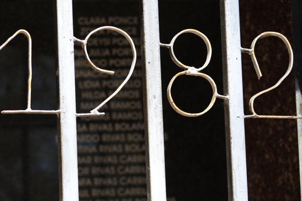 Metal doors enclose the plaques listing victims' names at the El Calabozo memorial / Photo Cristosal