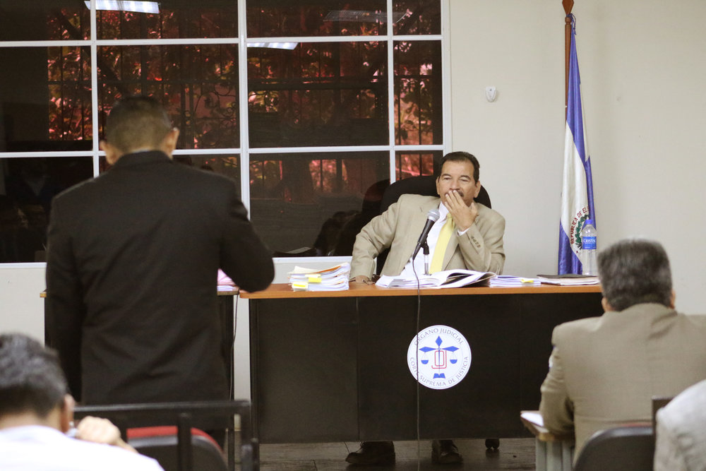 Judge Jorge Alberto Guzmán listens to a representative from the Attorney General's Office during a hearing in the El Mozote case. / Photo Cristosal