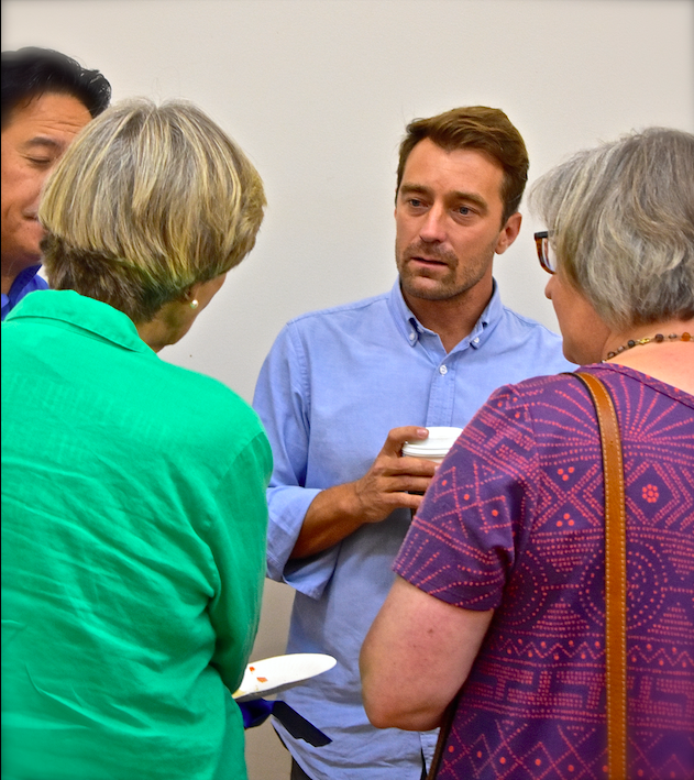 Noah talks with guests at All Saints' Palo Alto reception, Sept. 9
