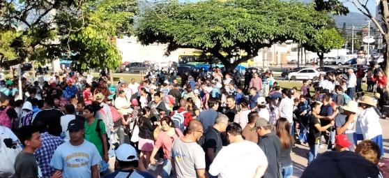 A migrant caravan prepares to leave from Salvador del Mundo in San Salvador on October 31.