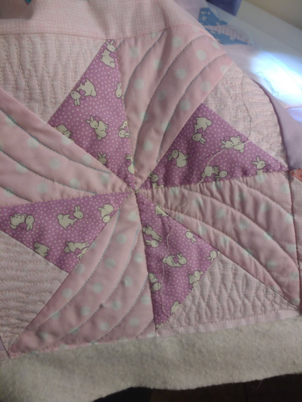 I was surprised that the curves were one of the harder things to free motion quilt. I had trouble maintainting stitch length and smooth cuves.