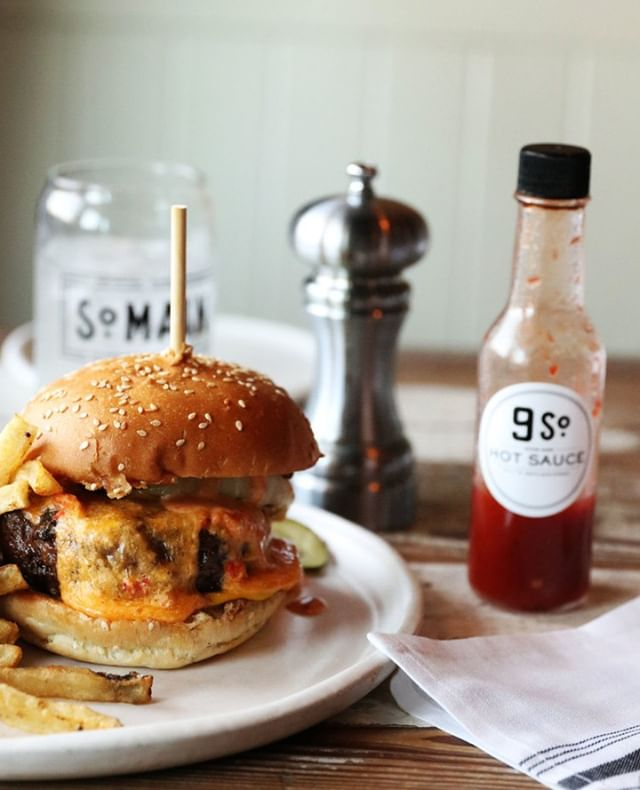 Rain or Shine a burger is always a good idea. | W. All Good Burger with our house hot sauce captured by @farmdus