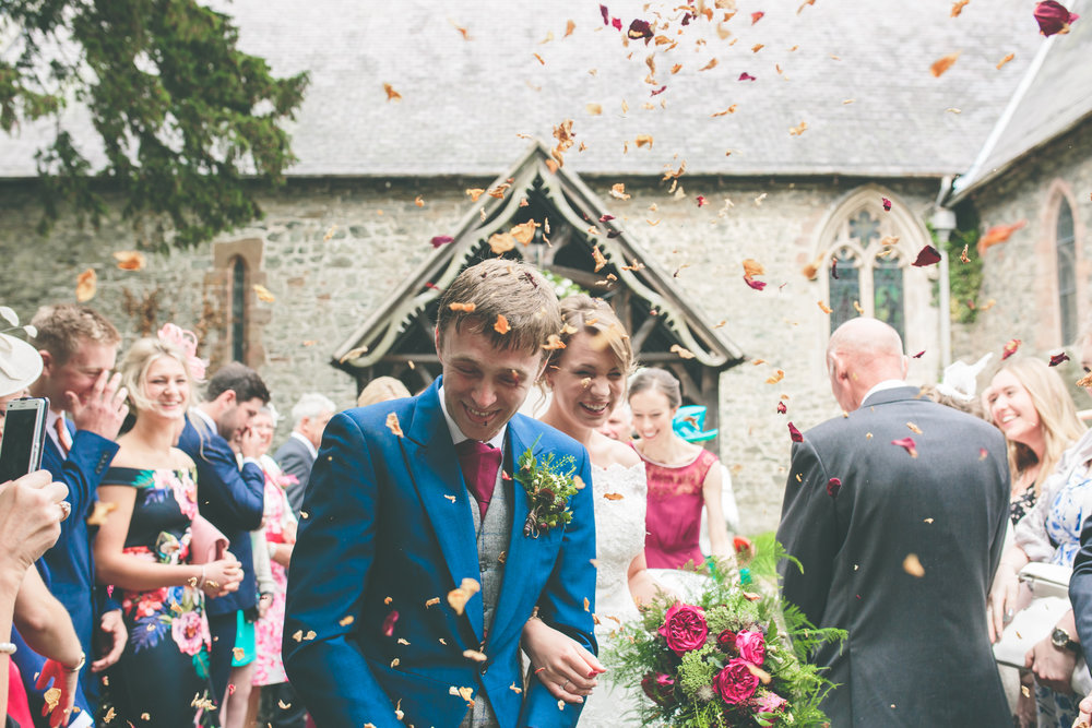 Confetti shot, Montgomery Church, Powys wedding photographer