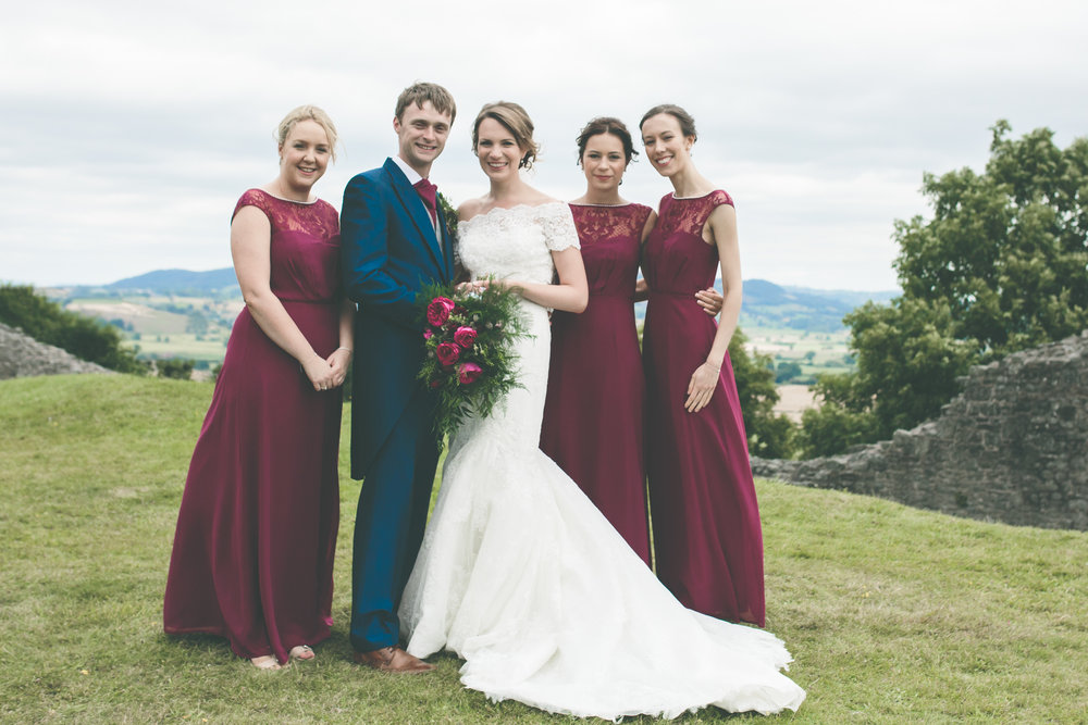 Couple with bridal party, Montgomery Castle wedding photography