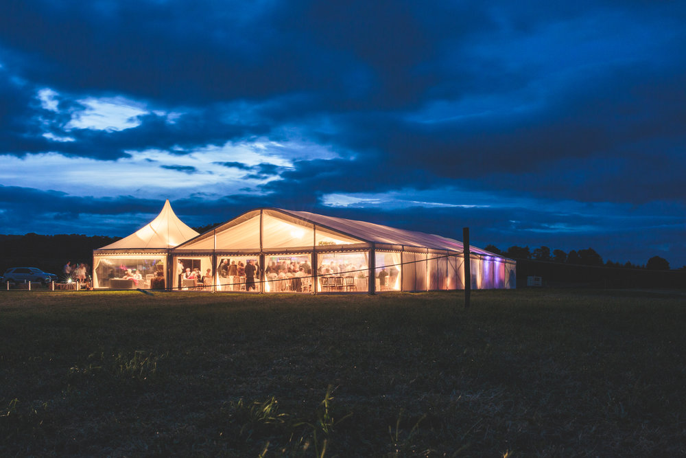 Marquee at night, UK wedding photographer Olivia Moon