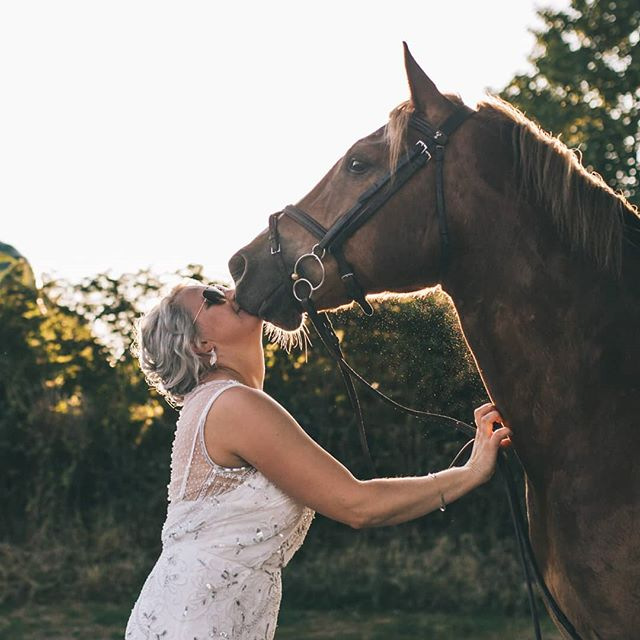 Laura really wanted to ride her horse to her wedding, but had to settle for a golden hour photoshoot with him instead as he's a bit boisterous! Gorgeous dress by @airebarcelona at @dollybluebridalstudios.