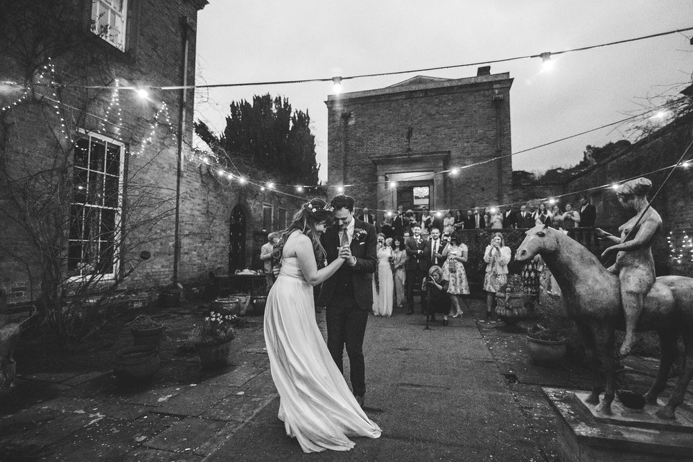 Festoon lighting first dance wedding photography