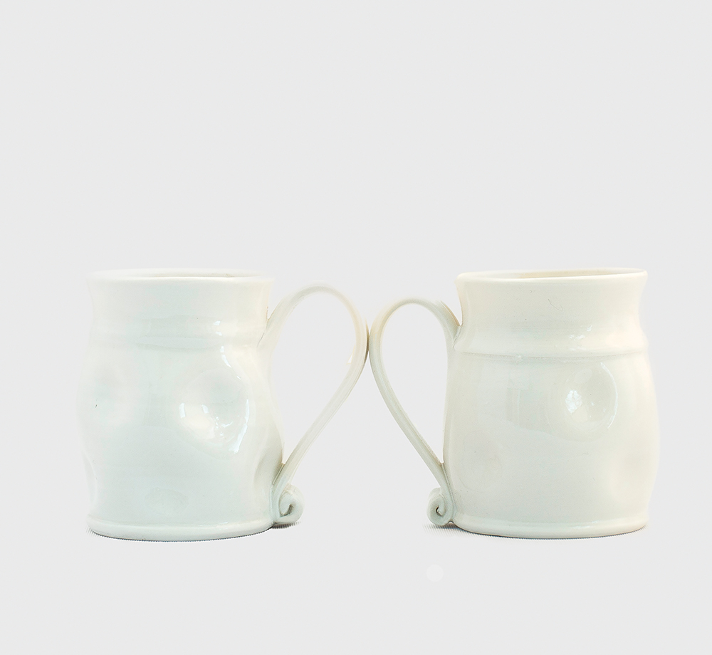 White dimple mugs  £22 each