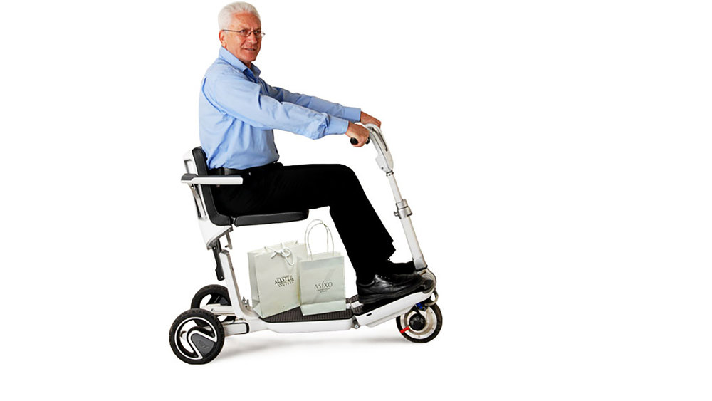 """When unfolded, ATTO's rear track expands to 56cm/22"""" between the wheels for extra stability. Seat height and steering column height/reach are adjustable to suit you."""