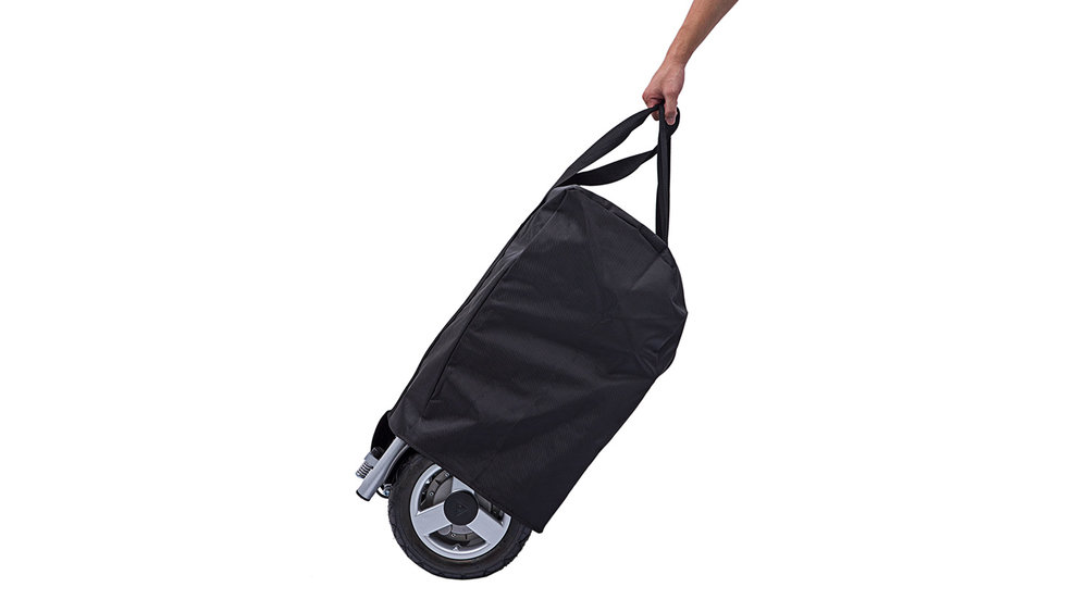 With the power chair in freewheel mode, it can be wheeled along easily using the straps on the protective cover.