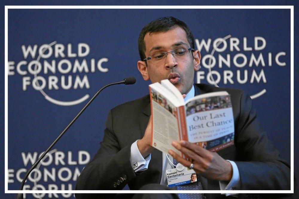Moderating a debate panel at the World Economic Forum (Davos, 2013)
