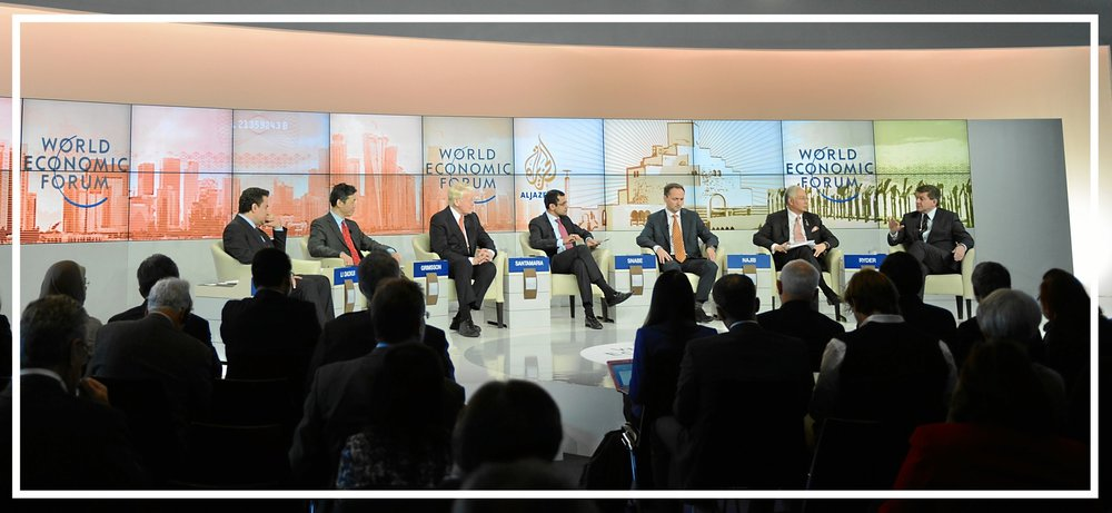 Moderating a televised panel at the World Economic Forum in Davos, 2013