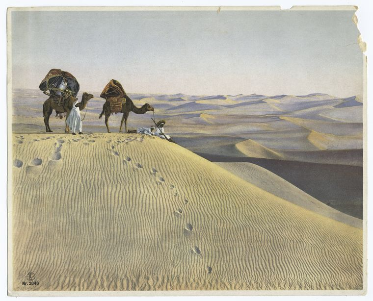 (Men_and_camels_in_the_desert.)
