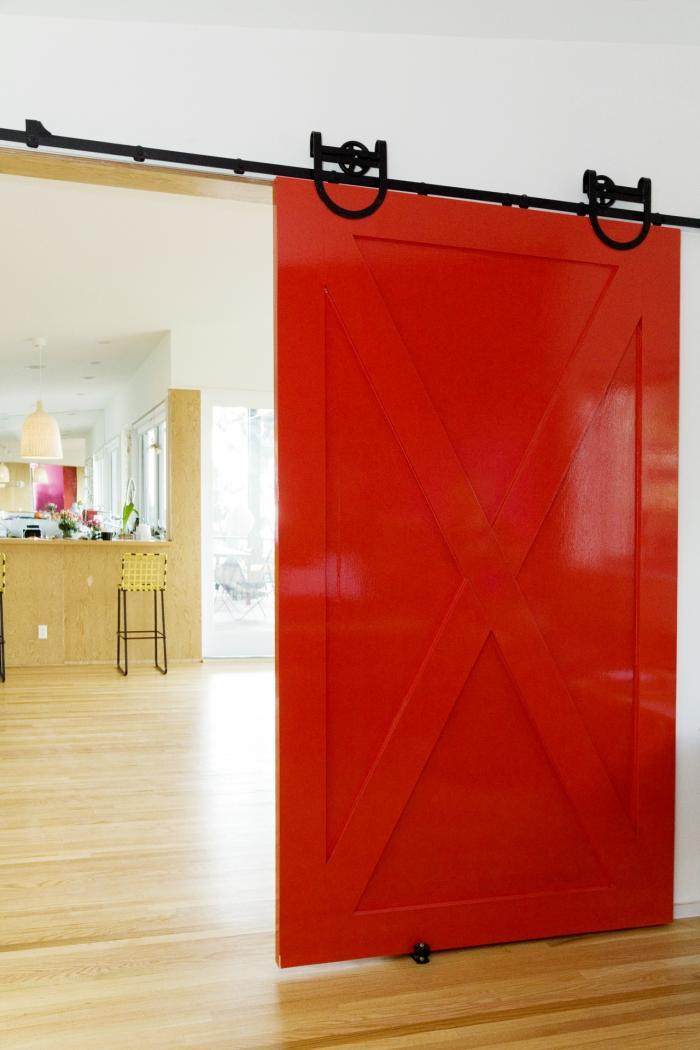 Bright red barn door by Los Angeles architect Barbara Bestor. Photograph by Aaron Farley for Paper Magazine