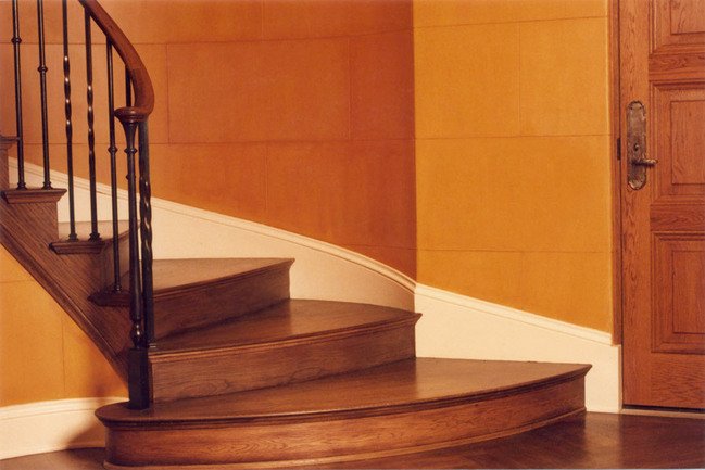 A landing detail, part of an elegant Mercer Island staircase.  Photo courtesy Seattle Stair & Design.