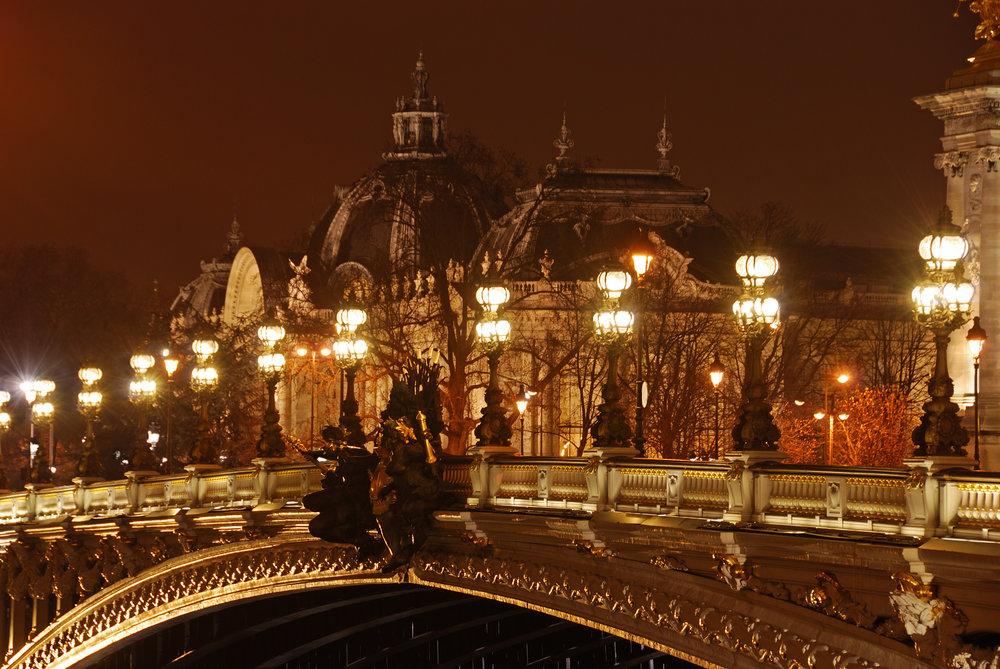 Pont d'Alexandre III, Paris. Illuminated beautiful bridge and Grand Palais by night..jpg