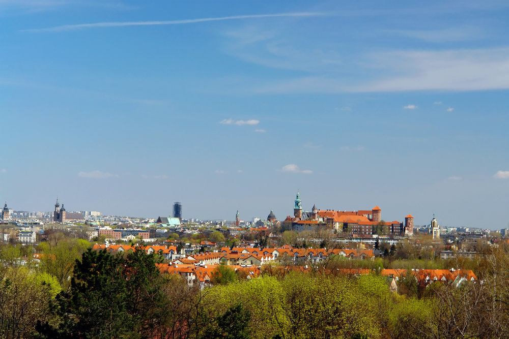 Panorama of Royal Castle Wawel and St. Mary Church in Krakow, Poland.jpg
