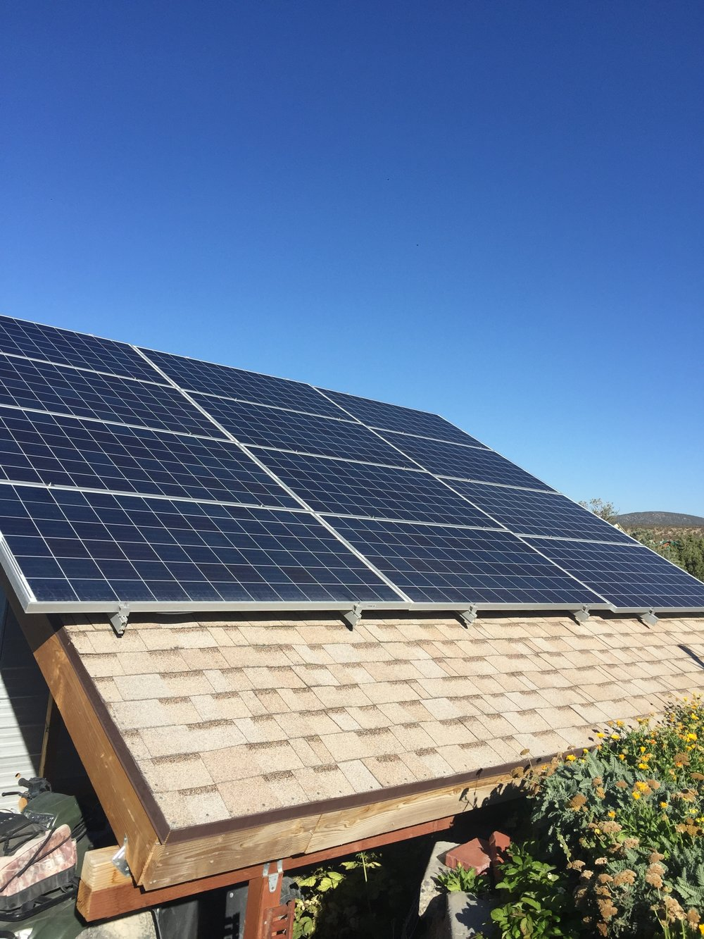Here is a picture of the solar panels. My husband built this stand, and I'm very proud of him. These panels are quite large---about 3 feet x 6 feet each.