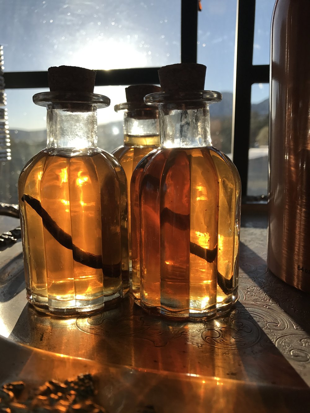 Yum! Homemade Vanilla Extract---ready to be given away or tucked away for later. Leaving a piece of vanilla bean in the bottle makes it look pretty cool too!