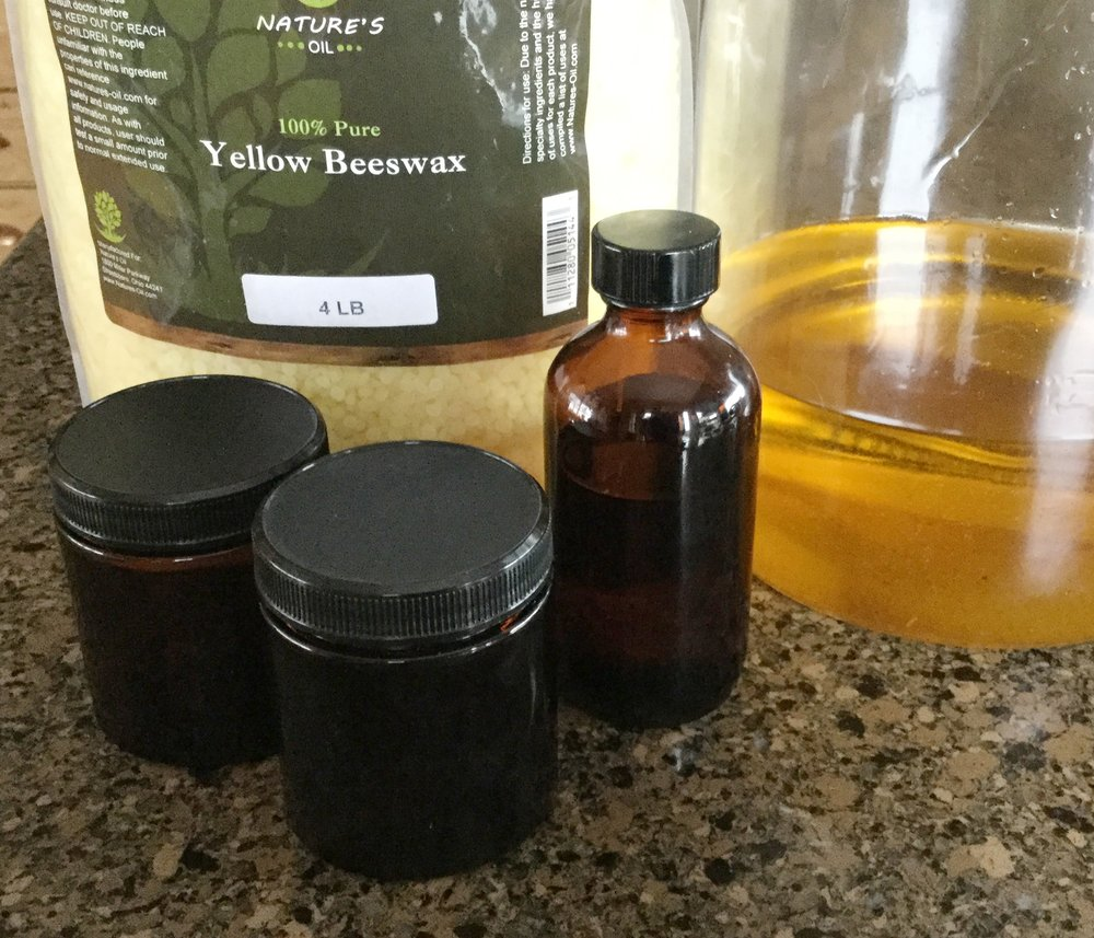 Main ingredients:  Almond oil (This has been infused twice with Calendula petals---that's why it's nice and golden, but you can use regular almond oil just fine!), Beeswax, amber glass jars for storing the salve when done, and my essential oil blend.