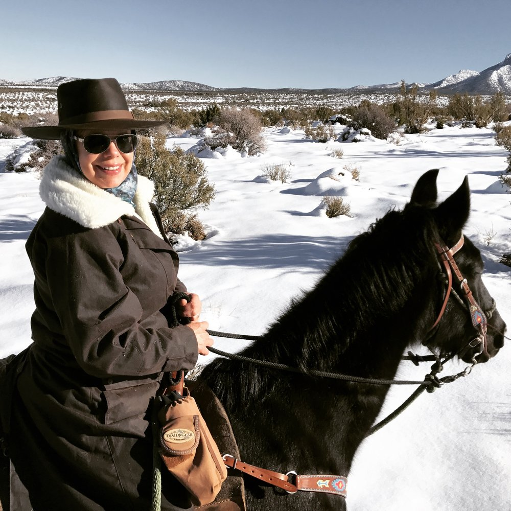 This is the  Outback Trading Company Oilskin Coat , a  Buff wool tube  (very thin) under the  Outback Trading Company hat .  The fleece liner is what you see on the collar.  The whole thing snaps right into the coat.  Except for my hands (my gloves were in my pocket), this was a great warm ride!