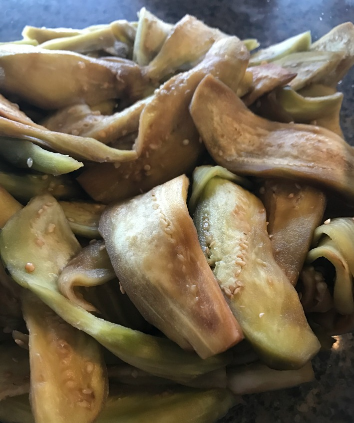 Here are the sliced eggplant. They've been sliced, massaged with some salt, and allowed to sit for about 30 minutes.  This really softens them up and releases the juices! It really helps the ferment for this vegetable.