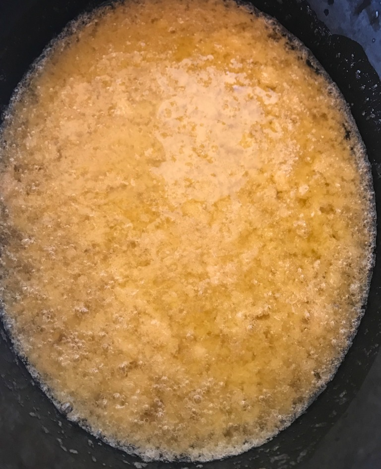 OH, NO!!!!! This is NOT a good sign when making hot process soap. Basically, the oils and liquids are separating, and unless something is done fast (re-emulsification), the chemical reaction that changes the molecular structure of the oils won't happen.  What's left? A big caustic mess.