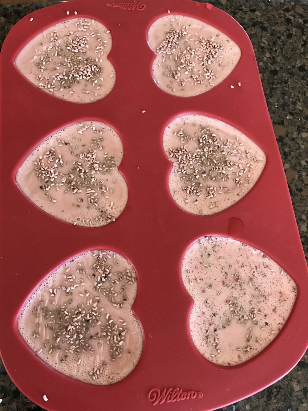 Here is some goats milk soap with French pink clay and raspberry seeds added.