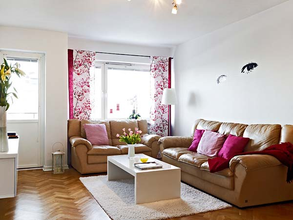 Cute-Small-Apartment-on-the-Edge-of-Modern-Living-Room-With-Brown-Sofa-White-Carpet-and-Pink-Curtain-Cozy-Apartment-Living-Room-Decorating-Ideas-For-Small-Spac