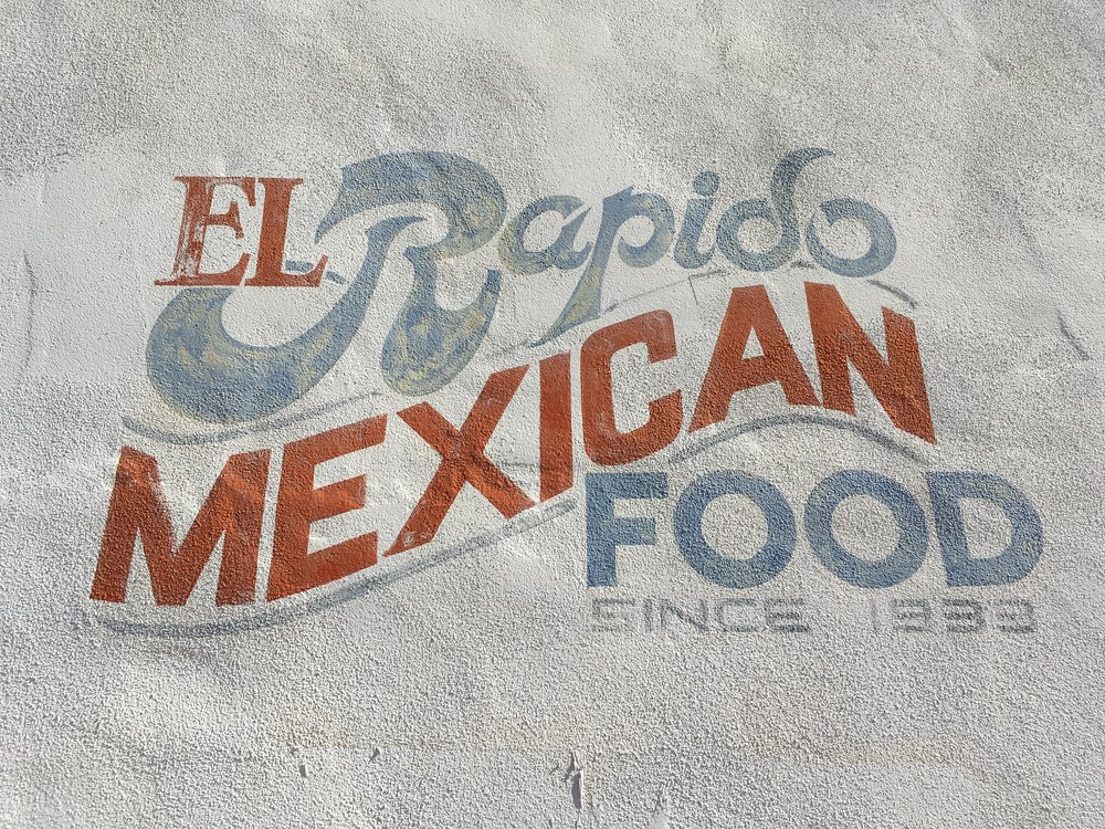 I wasn't there for the founding of El Rapido in 1933, but oh how I wish it still served up those paper thin flour tortillas around red chile. I miss it every time I walk by this sign in the El Presidio neighborhood on the north side of downtown. The lunchtime line at this tiny shop used to extend outside the front door.