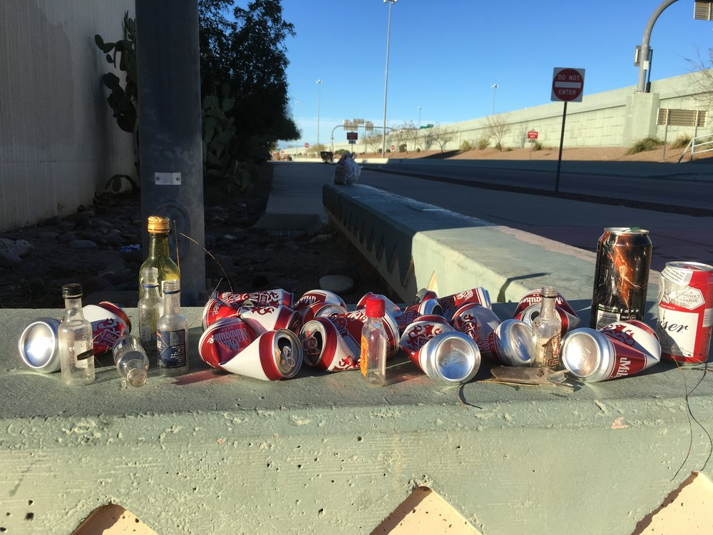 When these benches were installed along the I-10 frontage road, I thought they looked nice. But now I realize that the only people who sit on them are drifters who then dispose of their trash behind the benches. Here's just the alcohol litter I picked up behind one bench at near 18th Street.
