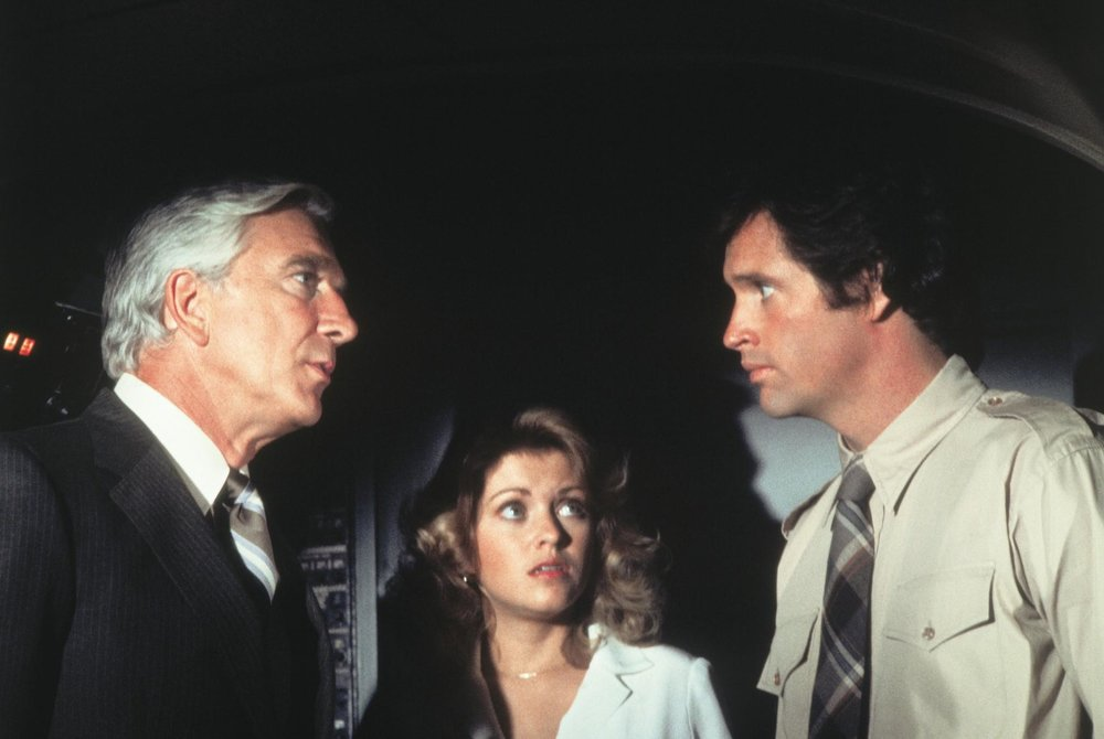 picture-of-leslie-nielsen-robert-hays-and-lorna-patterson-in-airplane--large-picture.jpg
